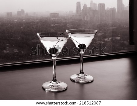 Cocktail glasses with city view - stock photo