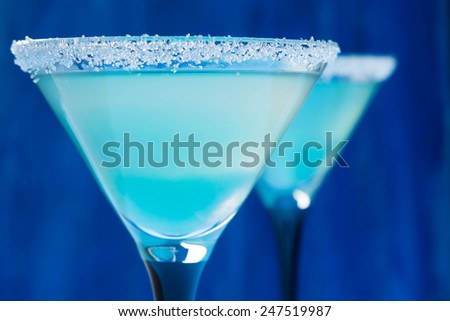 Cocktail in martini glasses on the bar table - stock photo