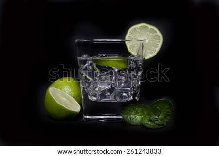 Cocktail ina a glass with ice and lime, Cocktail in a a glass - stock photo