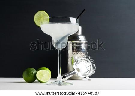 Cocktail margarita on the dark wooden background - stock photo