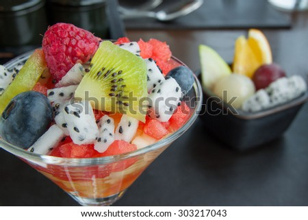 cocktail of fresh fruits salad  - stock photo