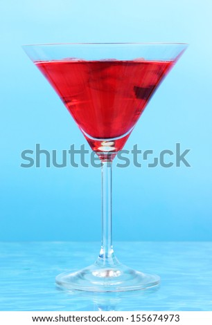 Cocktail on bright background - stock photo