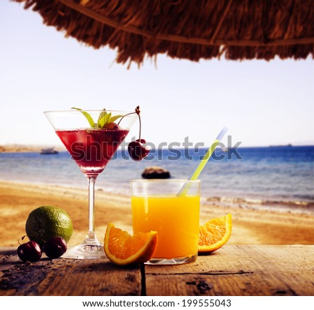 Cocktail on the beach. Summer concept - stock photo