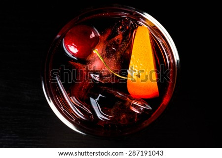 Cocktail on the black wooden table - stock photo