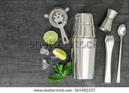 Cocktail shaker and aperitif ingredients. Mojito. Caipirinha - stock photo