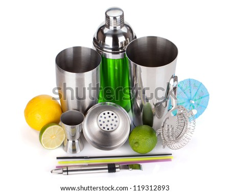Cocktail shaker, strainer, measuring cup, drinking straws and citruses. Isolated on white background - stock photo