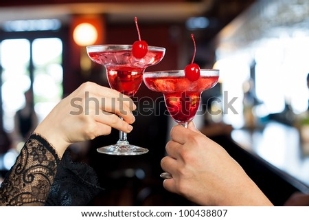 Cocktail toasting - stock photo