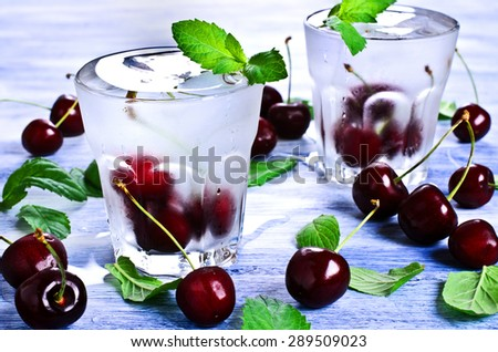 Cocktail with cherry and mint in a chilled glass - stock photo