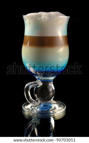 cocktail with coffee and whipped milk and liqueur curacao - stock photo