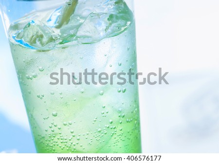 cocktail with green lime - stock photo