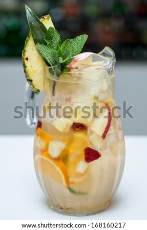 Cocktail with lime and pineapple in a glass - stock photo