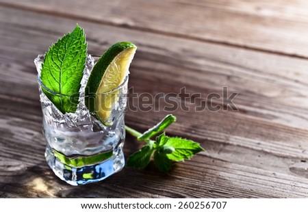 cocktail with lime , ice  and peppermint leaves  - stock photo