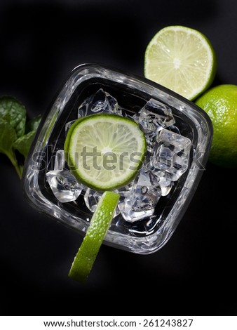 cocktail with lime on black background, Cocktail with lime - stock photo