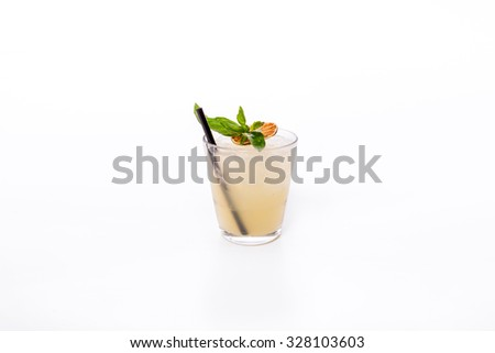 Cocktail with orange garnish and mint - stock photo