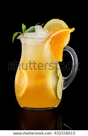 Cocktail with orange juice over black background - stock photo