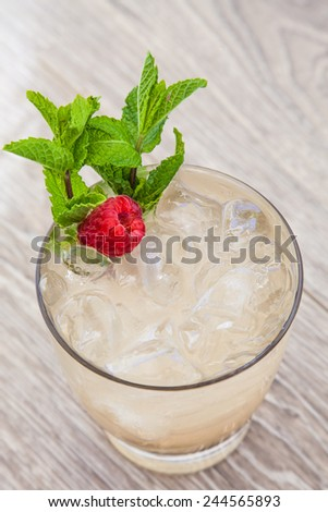 Cocktail with raspberry and mint garnish. - stock photo