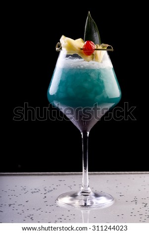 cocktail with rum, pineapple juice and blue curacao - stock photo