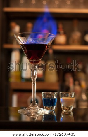 Cocktails and ingredients on the bar counter. - stock photo