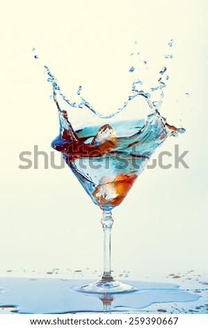 Cocktails isolated on white background. Splash. martini glass - stock photo