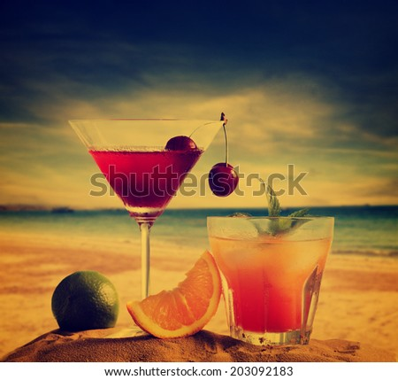 Cocktails on the beach in retro style - stock photo