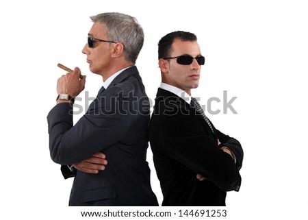 Cocky men in smart suit - stock photo