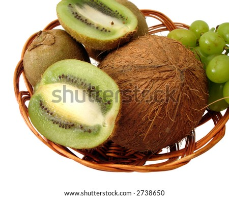 coco, green kiwi and grapes in basket over white background - stock photo