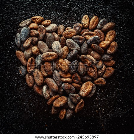 Cocoa beans in the shape of hearts  - stock photo
