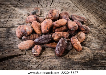 Cocoa beans on wooden background. Organic food - stock photo