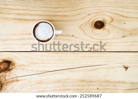 cocoa cup top view on old wooden - stock photo
