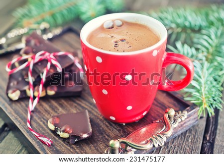 cocoa drink and chocolate with nuts on a table - stock photo