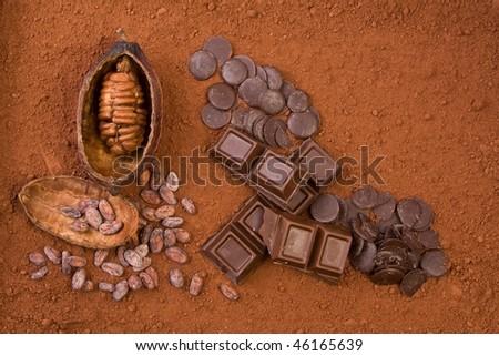 cocoa fruit, cocoa powder and chocolate - stock photo