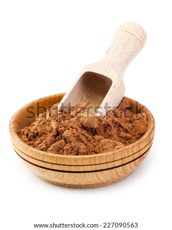Cocoa powder in wooden bowl isolated on white background - stock photo