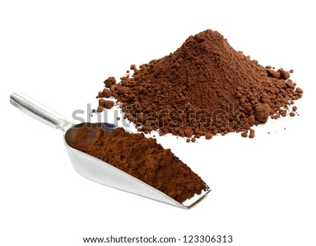 Cocoa powder pile with scoop on white background - stock photo