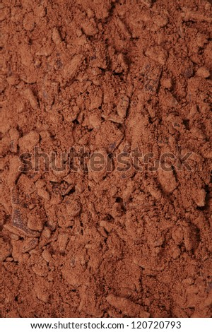 cocoa powder with small pieces of chocolate on background , shallow DOF - stock photo