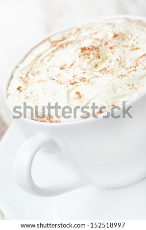 cocoa with cinnamon and whipped cream close-up, selective focus, vertical - stock photo