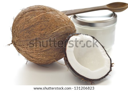 Coconut and organic coconut oil in a glass jar on white background. - stock photo