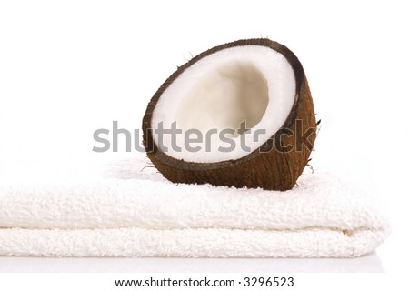 coconut and white towel. exotic, tropical scene. beautyfarm - stock photo