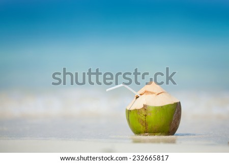 Coconut at the beach - stock photo