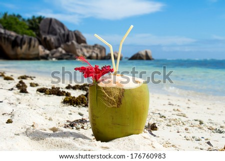 Coconut cocktail on a beautiful beach - stock photo