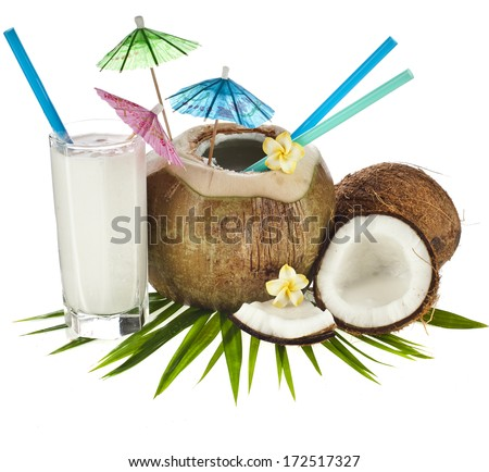 Coconut drink with a straw and palm leaf isolated on white background - stock photo