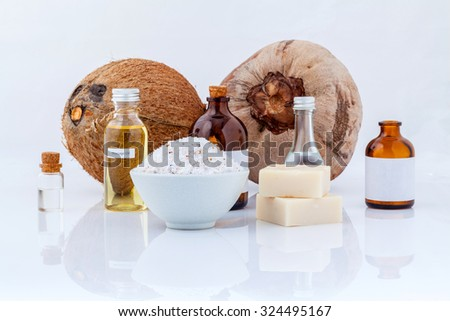 Coconut essential Oils natural Spa Ingredients for scrub ,massage and skin care isolate on white background. - stock photo