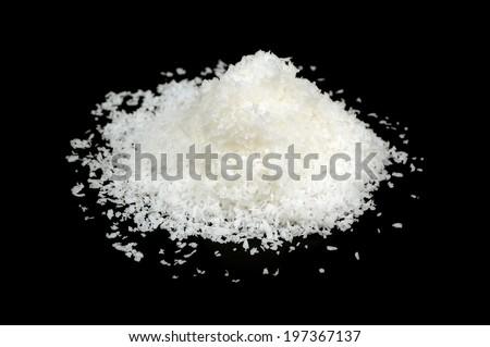 Coconut Flakes on Black Background - stock photo