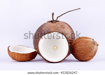coconut half clipping path for coconut milk and brown coconut shell and ripe coconut  on white background healthy fruit food isolated  - stock photo
