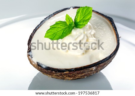 Coconut ice cream in coco shell on the plate - stock photo