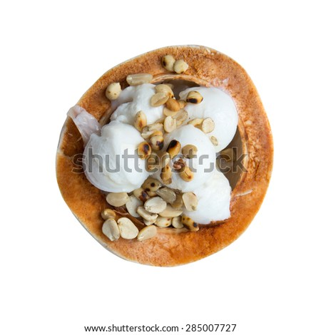 coconut Ice Cream with nuts on white background - stock photo