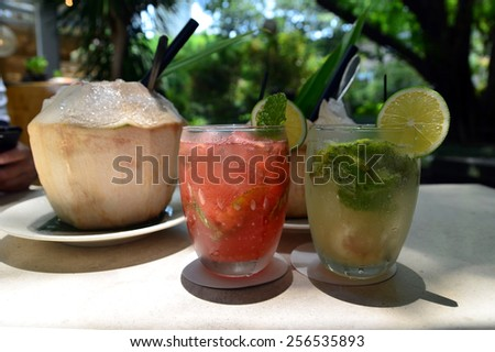 Coconut juice and cocktails - stock photo