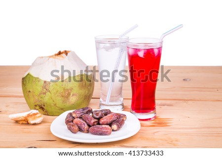Coconut juice, syrup and sweet dates are simple and common iftar break fast food during fasting month of Ramadan - stock photo