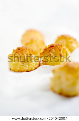 Coconut macaroons shot with selective focus against a light background. Copy space. - stock photo