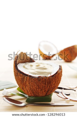 Coconut mousse dessert served in a coconut - stock photo