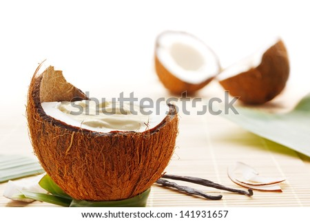 Coconut mousse dessert with coconuts and vanilla beans - stock photo